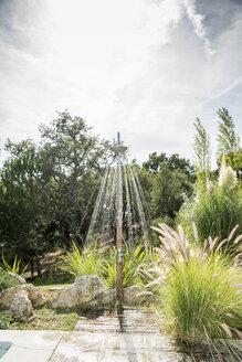 Portugal, Outdoor shower in garden - CHPF00345