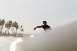 Indonesia, Bali, surfer in the sea - KNTF00580