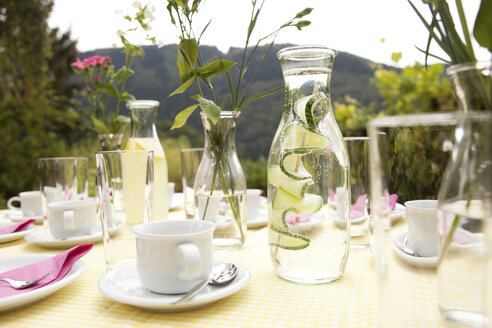 Laid table in garden, decorated for a birthday party - MFRF00724