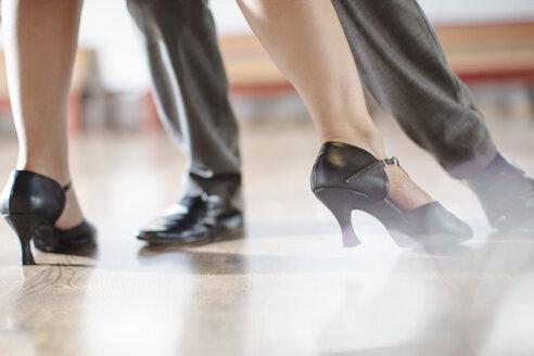 Feet of dancing couple in studio - ZEF11724