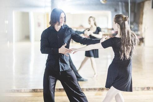 Couple dancing tango in studio - ZEF11736
