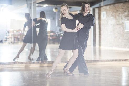 Couple dancing tango in studio - ZEF11739