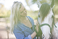 Woman with horse on horse farm - ZEF11743