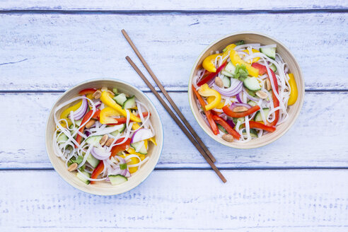 Two bowls of glass noodle salad with vegetables on wood - LVF05616