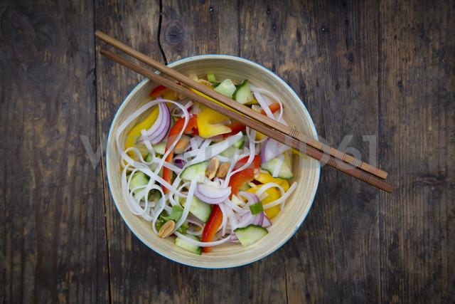 Bowl of glass noodle salad with vegetables on wood - LVF05619