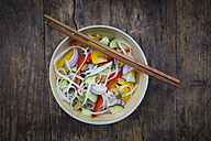Bowl of glass noodle salad with vegetables on wood - LVF05619
