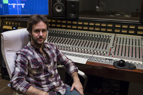 Portrait of a man in the control room of a recording studio - ABZF01550