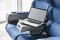 Laptop and smart phone on airline seat - JOSF00385