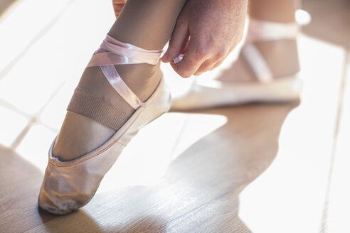 Ballet dancer putting shoes on - ZEF11762