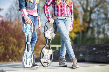 Two girls with skateboards, partial view - MAEF12054