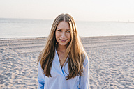 Portrait of smiling young woman on the beach - KNSF00695