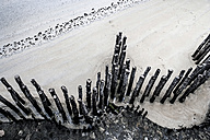 France, Lancieux view to wooden stakes on the beach from above - FMKF03258