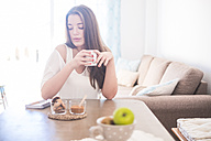 Young woman drinking coffee at home - SIPF01131