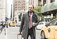 USA, New York City, businessman on the move in Manhattan - UUF09322
