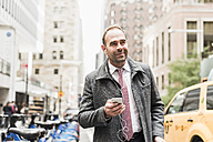 USA, New York City, businessman on the move in Manhattan - UUF09325