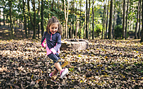 Happy little girl playing in the woods - DAPF00480