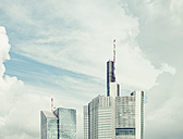 Germany, Frankfurt, upper parts of two skyscrapers in front of dramatic clouds - KRPF02041