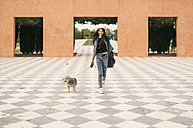 Young woman going walkies with her dog - JASF01309