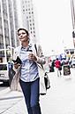 USA, New York City, businesswoman in Manhattan on the go - UUF09407