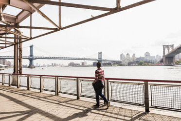 USA, New York City, woman walking at East River - UUF09425