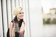 Portrait of smiling blonde woman with scarf - TAMF00852