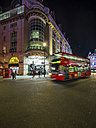 UK, London, Piccadilly Circus, driving double-decker bus at night - AM05093