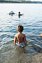 Back view of little boy in the sea - VABF00850