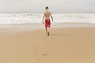 Boy walking on the beach - NMSF00001