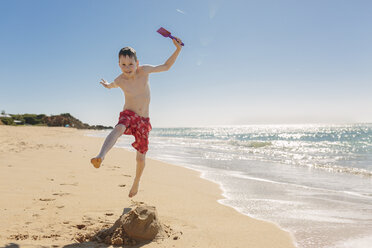 Boy playing and jumping on the beach - NMSF00007