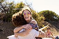 Happy couple hugging outdoors in summer - WESTF21980
