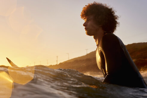 Surfer in the sea at sunset - WESTF22070