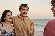 Friends on the beach in the evening - WESTF22073