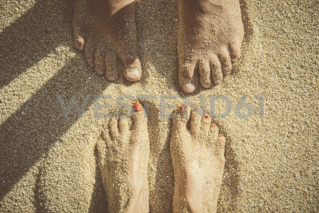 Feet of a couple standing in the sand seen from above - CHPF00352