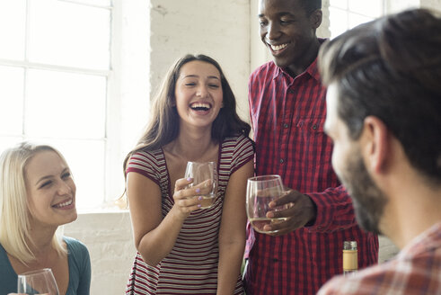 Happy friends drinking wine in a loft - WESTF22135
