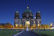 Germany, Berlin, view to lighted Berliner Dom with television tower in the background - GFF00908