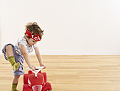 Little girl playing with pedal car - FSF00623