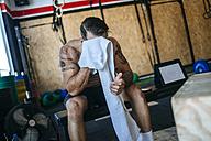 Man resting in gym - KIJF00971