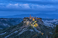 Italy, Lazio, view to Civita di Bagnoregio at blue hour - LOMF00447