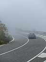 Italy, Sicily, car driving on pass of Mount Etna at heavy fog - AMF05115