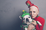 Portrait of woman and her French bulldog at Christmas time - RTBF00533