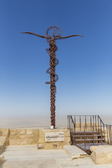 Jordan, Mount Nebo, Memorial cross with snake remininding of the death of Moses - MAB00411