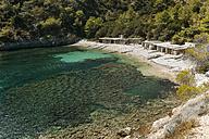Spain, Ibiza, Fishermen's huts at Llentrisca Beach - KIJF01008