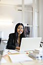 Young Asian woman working in office using laptop - EBSF01911