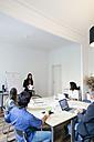 Business people having a team meeting in office - EBSF01926