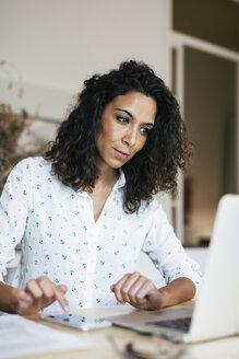 Businesswoman working in office - EBSF01935