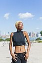USA, New York City, Brooklyn, young woman enjoying the sunshine - GIOF01669
