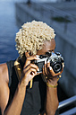 Young woman with camera taking pictures - GIOF01675