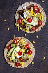 Two Mexican Tortillas with mincemeat, avocado, tomato, corn, Jalapeno pepper and sour cream - SBDF03093