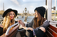 France, Paris, two smiling women on a tour bus - MGOF02628