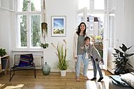 Happy mother with daughter at home - FKF02100